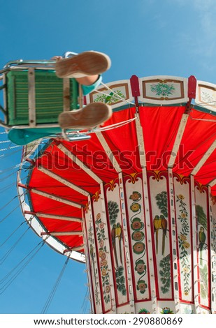 Colorful merry-go-round carousel on a theme park  spinning around - stock photo