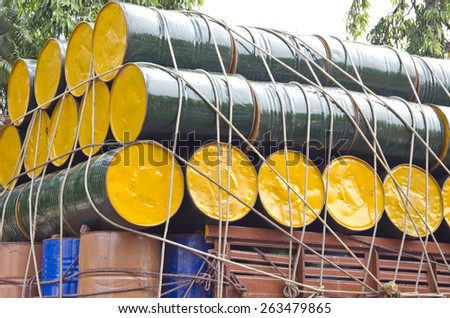 colorful metal oil barrels stacked  for cargo in India - stock photo