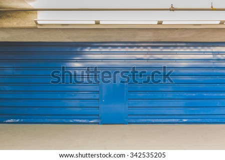colorful metal texture surface with the door in the parking lot. - stock photo