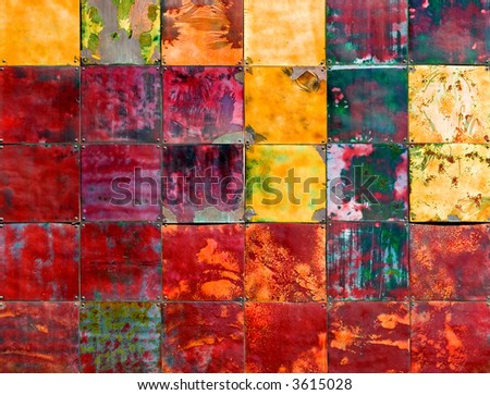 Colorful metallic art piece on the wall - stock photo