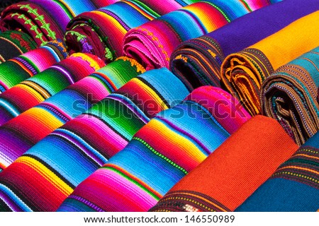 Colorful Mexican blankets for sale at market, Latin America. Mexico travel background. - stock photo