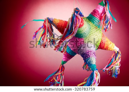 Colorful mexican pinata used in birthdays on red background - stock photo