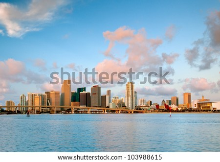 colorful miami waterfront skyline and harbor in pink dawn light, as seen from macarthur causeway, 2012 - stock photo