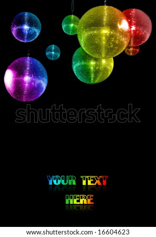 colorful mirror party balls against black background. just add your text - stock photo