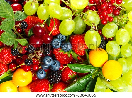 colorful mix of fresh fruits and berries - stock photo