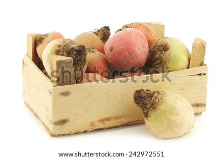 colorful mix of red,yellow and white beets in a wooden box on a white background - stock photo