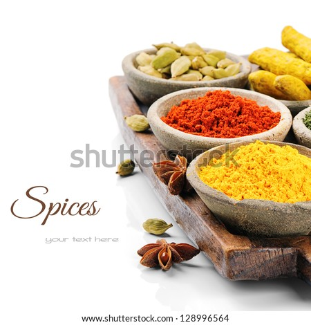 Colorful mix of spices isolated over white