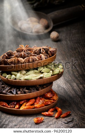 Colorful mix of spices on old wooden table - stock photo