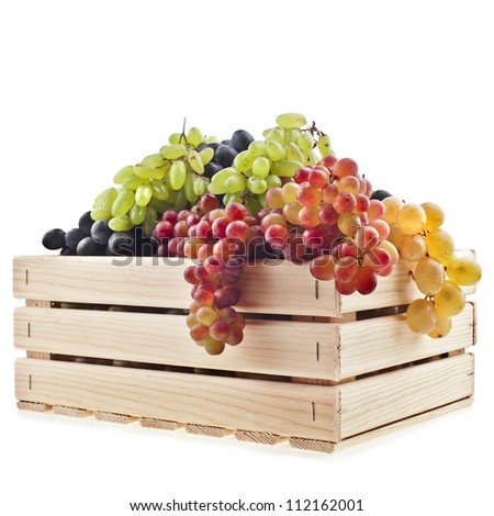 colorful  mixed grapes in a wooden box crate  isolated on a white background - stock photo