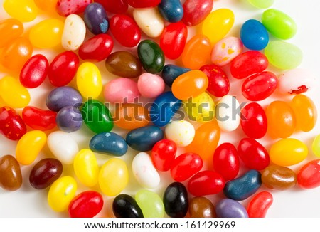 Colorful mixed jelly beans on white background - stock photo