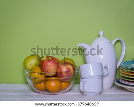 Colorful modern kitchen with fruits and utensil on wooden table/ healthy lifestyle concept