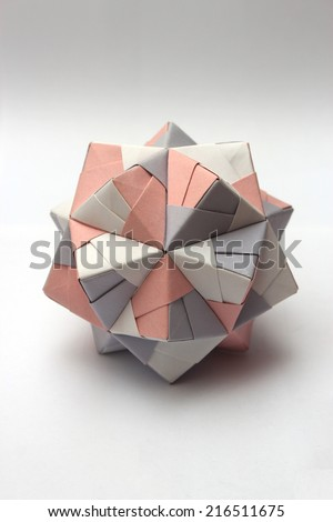 Colorful modular origami ball isolated on white - stock photo