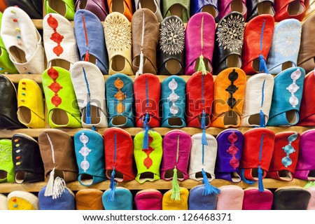 Colorful moroccan babouche shoe slippers in a shelf. - stock photo
