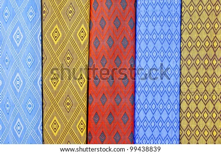 Colorful moroccan rugs on the market - stock photo
