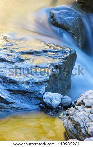 Colorful mountain creek in the Pyrenees, Pineta Valley, Aragon, Spain. - stock photo
