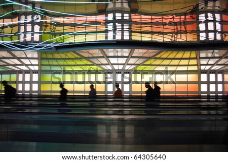 Colorful moving walkway in Chicago O?Hare Airport - stock photo