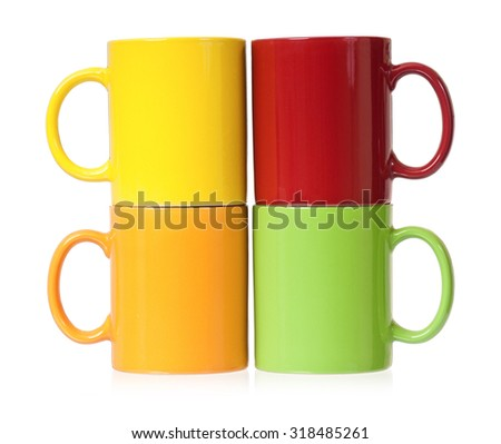 Colorful mugs for coffee or tea, isolated on white background - stock photo