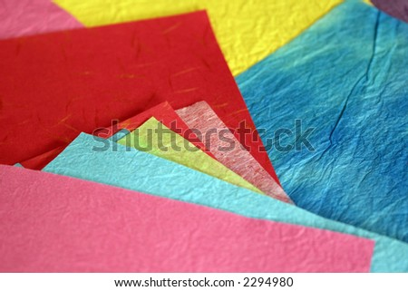 Colorful mulberry paper of different sizes arranged so many colors can be seen.