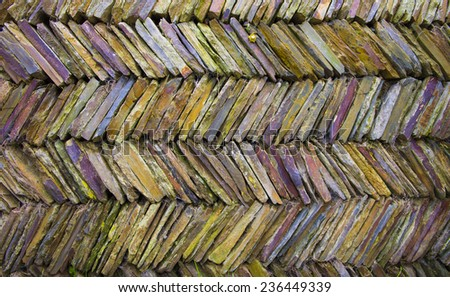 Colorful Multi colored slit like tile creates a wall - stock photo