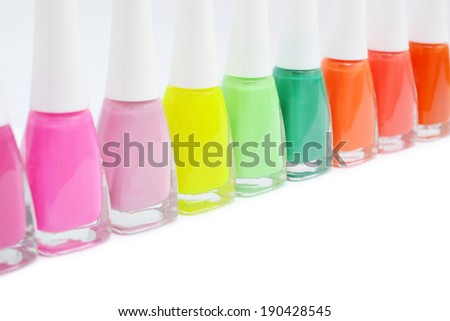 Colorful nail polish on white background with copy space. Macro with shallow dof. - stock photo