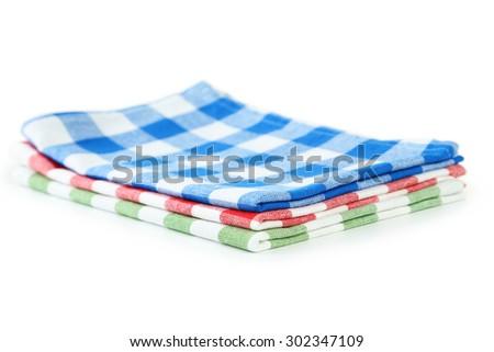Colorful napkins isolated on white - stock photo