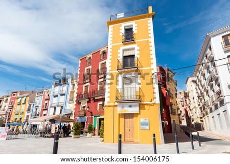 Colorful narrow street in an Spanish coastal village - stock photo