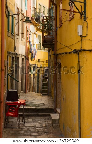 colorful narrow street in  in down town of Porto, Portugal - stock photo