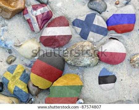 Colorful National flags of the nine Baltic sea states on stones - stock photo