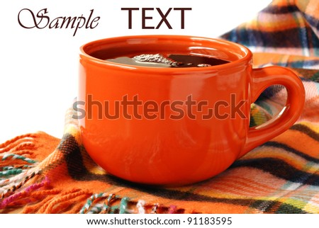Colorful neck scarf with cup of hot tea or coffee on white background with copy space.  Conceptual image for comfort and warmth during cold season. - stock photo