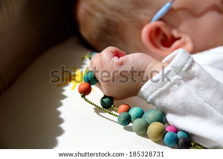 Colorful Necklace In a Baby Hand