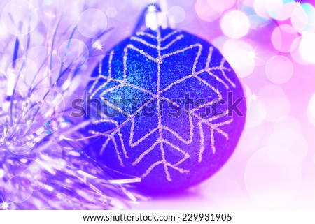 Colorful neon christmas ball on new year's lights bokeh background - stock photo