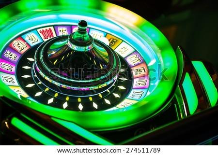 Colorful Neon Illuminated Roulette Casino Game Closeup. Las Vegas Casino Games. - stock photo