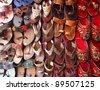 Colorful nepali shoes alignment in a shop - stock photo
