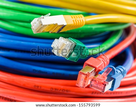 Colorful network cable with RJ45 connectors - stock photo