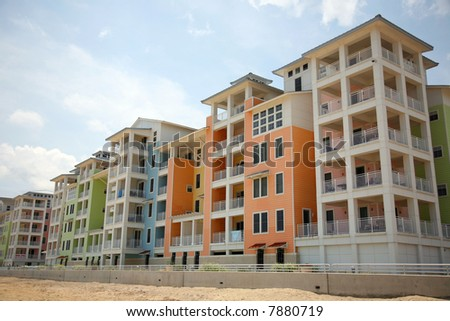 colorful new condominiums on the beach - stock photo
