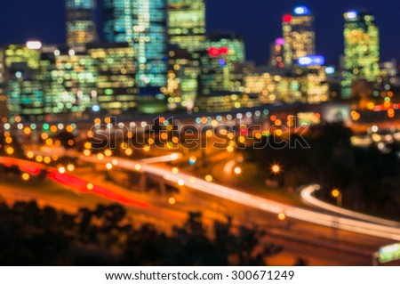 Colorful night of abstract bokeh and blured lighhts from peak of Perth city, Australia - stock photo