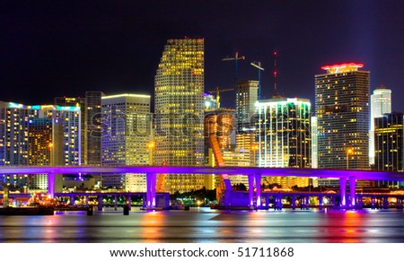 Colorful night view of city of Miami Florida with downtown buildings in the financial business district and Biscayne bridge bridge - stock photo