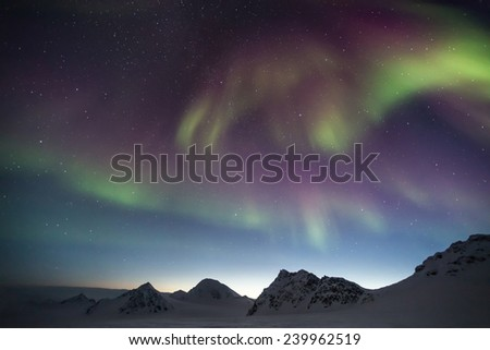 Colorful Northern Lights - Arctic winter mountain landscape - stock photo