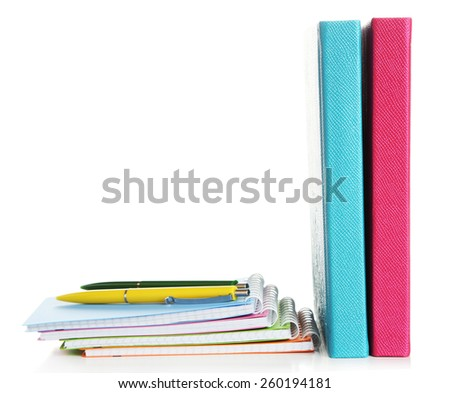 Colorful notebooks and pen, isolated on white