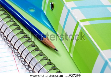Colorful notebooks with paper and pencil.  Macro with selective focus on pencil point. - stock photo