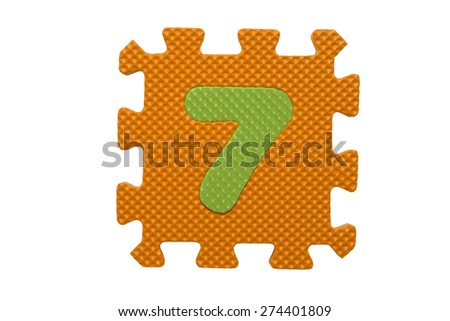 """Colorful number puzzle. Alphabet puzzle pieces isolated on white background. Number learning block for children education. The number  """"7"""" is a set of alphabet made in the form of a puzzle,Easy to cut - stock photo"""