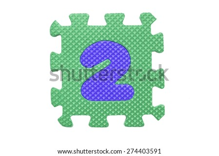 """Colorful number puzzle. Alphabet puzzle pieces isolated on white background. Number learning block for children education. The number  """"2"""" is a set of alphabet made in the form of a puzzle,Easy to cut - stock photo"""