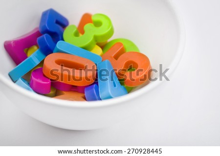 Colorful numbers in a bowl. 'Food for young brains' an idea.  - stock photo