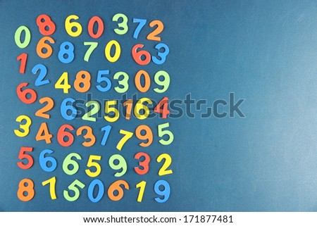Colorful numbers on school desk background