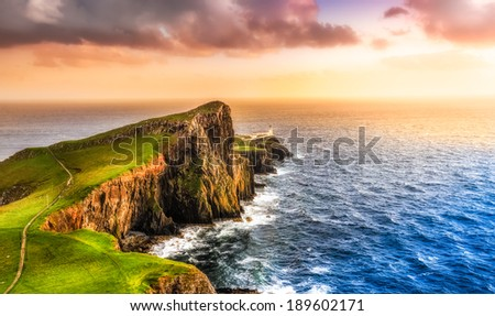 Colorful ocean coast panoramic sunset at Neist point lighthouse, Scotland, United Kingdom - stock photo