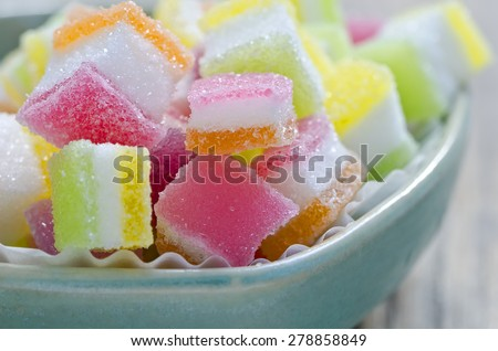Colorful of candy jelly in ceramic bowl put on wooden background.Shallow DOF. - stock photo