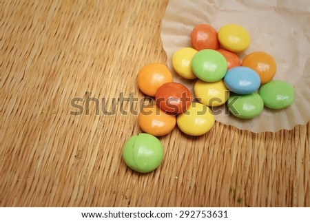 Colorful of chocolate isolated on brown background