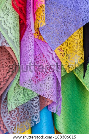 Colorful of fabric Lace rolls in shop, texture background. - stock photo