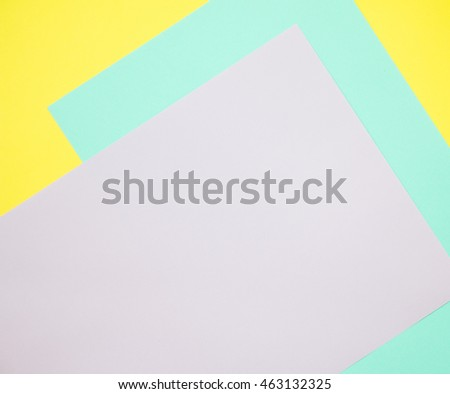Colorful of green and purple paper on yellow background.