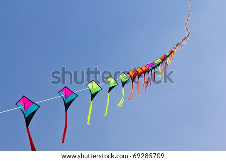 colorful of kite against blue sky - stock photo